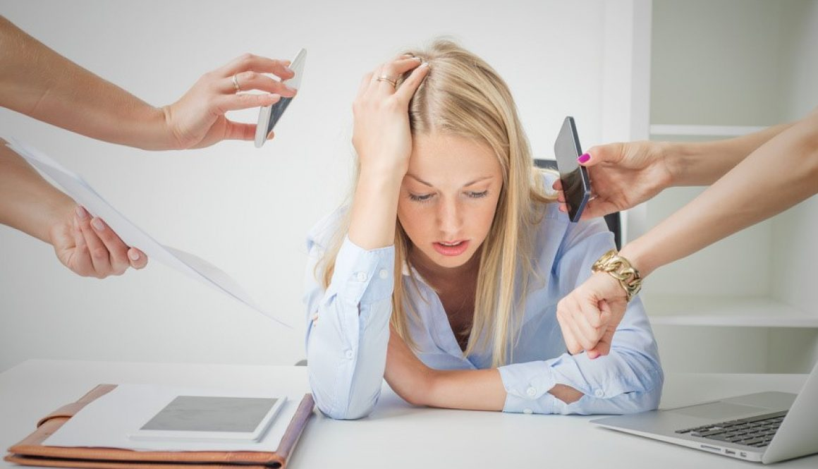 Woman overloaded with stuff at work